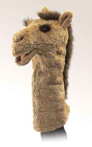 Make camel from old brown blanket or coat - child to operate - hand in head/neck - body becomes hump etc