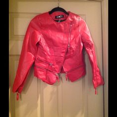 💥SALE NWT Red leather style jacket with zipper Red leather style jack with zipper detailing. Super hot and asymmetrical style as it zips from the top half way down. I ordered online and it's too small so I hope someone here can enjoy it! Marked a size small but fits more like XS. Oasap Jackets & Coats