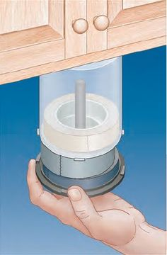 Reprupose a used CD or DVD spindle to make a nice storage solution for all your rolls of woodshop tape. #organization
