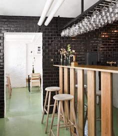 """A beer lover's mecca serving locally brewed beers in a minimalist, not so """"manly"""" bar. Voted the best bar in Copenhagen by the Danish newspaper Politiken in Black Subway Tiles, Black Tiles, Commercial Design, Commercial Interiors, Bodega Bar, Bar Interior, Interior Design, Turbulence Deco, Wine Glass Rack"""
