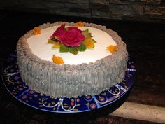 Cream cake with roses. Chocklade cream surrounded cake.