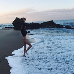 The Dope Surf Society® Beach girl playing in the ocean water