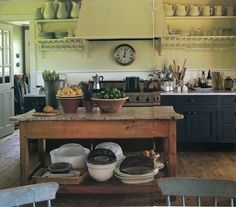 Love the open shelving and antique island.