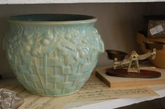 love mccoy pottery. I have 2 of these that were my Mom's!  One is this green and the other is a smaller white.