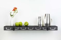 The graphical translation of lace into steel makes for a stylish design that looks good in various styles of interior. The Granny wall shelf combines refined design with unexpected strength. This makes it ideal for the elegant displaying of plants, (cook) books, pots and pans, tableware, children's toys, bathroom stuff or even something like a flat-screen.