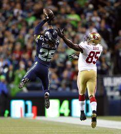 Seattle's Richard Sherman (left) intercepts a pass intended for San Francisco's Vernon Davis (85) in the fourth quarter.