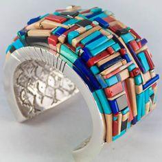 Bracelet | Ken Romero (Pueblo).  Sterling silver withturquoise, coral, opal, pink coral, walrus tusk, lapis, black jade, and chariote