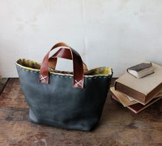 Rustic hand-stitched book tote by ThePaperMachine  LIke the scrap leather idea for the handles