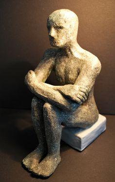 Amira Del Bono.    Seated man
