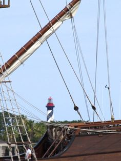 Shot of the St. Augustine Lighthouse seen through the mast and rigging of El Galeon
