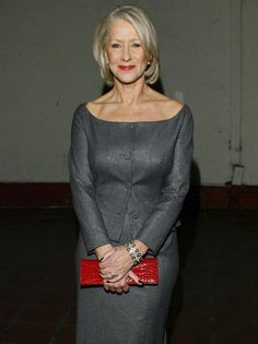 Helen Mirren shows off her flawless décolletage in this scoop neck grey dress in 2007.