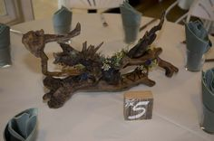 Here is an example of the  unique driftwood centerpieces that Matt and Katie Strand created out of driftwood.  They even used a branding iron to inscribe their initials.  I accented them with  flowers and succulents.The flowers included larkspur, eucalyptus, waxflower, eryngium and several types of succulents. Driftwood Wedding Centerpieces, Types Of Succulents, Branding Iron, Wild Flowers, Initials, Create, Unique, Wildflowers