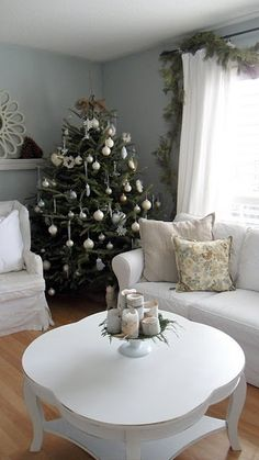 All white living room decorated for the holidays. Simple and pretty.