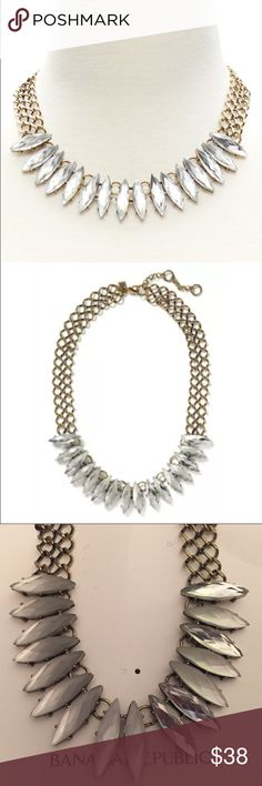 Banana Republic Stone Focal Statement Necklace This unique statement necklace from Banana Republic is elegant with crystals and a dark gold chain. Most stones are cloudy and iridescent and some are clear but it makes the piece look antiqued. Brand new, never worn. Price firm unless bundled. Banana Republic Jewelry Necklaces