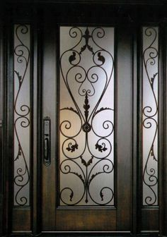 An exquisite and stylish Decorative Wrought Iron Front Door Insert Collection th. Iron Front Door, Glass Front Door, Front Doors, Wood Garage Doors, Wooden Doors, Iron Main Gate Design, Best Front Door Colors, Door Grill, Wrought Iron Doors