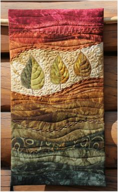 Simple but artistic; by Beret Nelson (on the trail creations) art quilt.