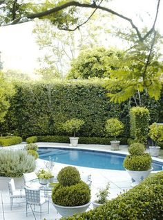 Summertime. Pool time. Interior Designer: Barbara Barry.