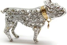 Side view - Art Deco diamond and ruby puppy brooch, circa 1905. Via Diamonds in the Library.
