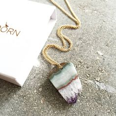 This many-layered piece. | 23 Mystical Amethyst Necklaces You'll Never Want To Take Off