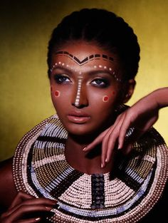 Google Image Result for http://www.eyeshadowlipstick.com/wp-content/uploads/2010/12/african-beauty.jpg (african beauty,african girl,painted face,beaded necklace,short hair,blue eyes)