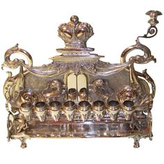 Antique Eastern European Silver Hanukkah Lamp | From a unique collection of antique and modern religious items at https://www.1stdibs.com/furniture/more-furniture-collectibles/religious-items/