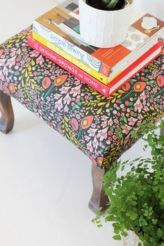 Learn how to make a simple reupholstered foot stool. It's a perfect home DIY project.