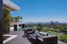 Architecture: Outdoor Terrace With Timber Deck And Outdoor Wooden Armchairs Also Wooden Coffee Table And Glass Railing Fence Design Ideas: Strikingly Luxurious Laurel Way Residence in Beverly Hills