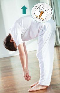 Rolling up from forward bend can damage your spine.