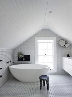 Design duo Poppy and Charlotte O'Neil of Poco Designs put their heads together to create this fresh monochromatic bathroom. For more see the current issue of Belle - on sale now! Photograph by Anson Smart. Loft Bathroom, Upstairs Bathrooms, Bathroom Interior, Modern Bathroom, Sloped Ceiling Bathroom, Bathroom Storage, Master Bathroom, Black And White Interior, White Interior Design