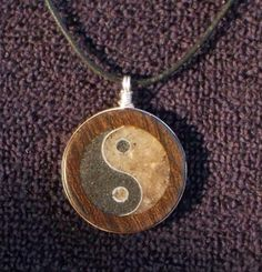 Handmade Yin Yang Wood Pendant with Magnetite by DonBurdaDesign, $50.00  https://www.etsy.com/listing/177484696/handmade-yin-yang-wood-pendant-with