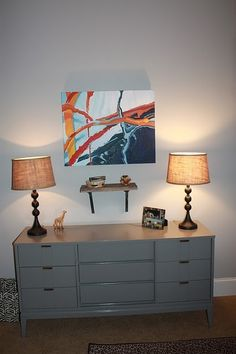 awesome mid-century dresser painted glossy gray.  Cool art, too