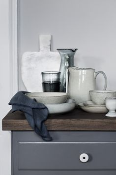 Gathered vases and ceramics in grey and white