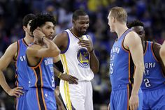Golden State Warriors' Kevin Durant (35) smiles with members of the Oklahoma City Thunder during the first half of an NBA basketball game Wednesday, Jan. 18, 2017, in Oakland, Calif. (AP Photo/Marcio Jose Sanchez)