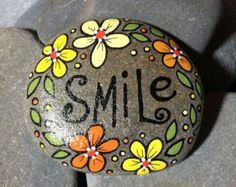 Hand-painted, one-of-a-kind Happy Rock - Live. Love. Laugh. - surrounded by pink flowers. This beautiful one-of-a-kind river rock was found on the banks of the Brewster River in Jeffersonville, VT. Not that you need a use for a Happy Rock, but there are many! Incorporate them into your home decor, garden, potted plants; they make great paper weights; some are useful in meditation; and of course they make great gifts. And Happy Rocks are smile provoking... you cant help but smile when you…