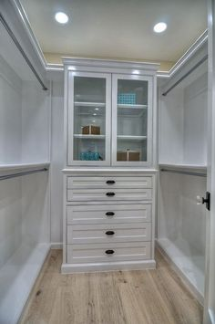 Contemporary Closet with Hardwood floors, Crown molding, New York Rosette Door Set with Waldorf-Crystal Glass Knobs