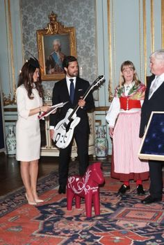 Sofia and Prince Carl Philip are showered with gifts at the Royal Palace.