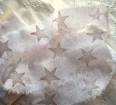 Star trim - looks like you just fray a strip of cloth, probably tearing along the bias - then stamp print a star, can work with acrylic paint, and without a stamp: carve a potato stamp.
