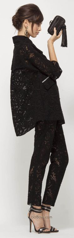 Ermanno Scervino Pre Collection 2013 Juxtapose thru wearing the lace trousers with a black leather jacket Nd boots