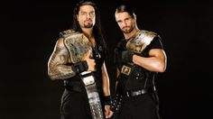 roman reigns with tag team gold  | ... Seth Rollins & Roman Reigns (World Tag Team Championships) Photoshoot