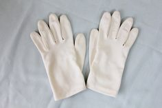 Check out this item in my Etsy shop https://www.etsy.com/listing/242431209/vintage-60s-white-gathered-wrist-gloves