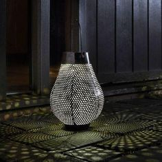 Create silhouette ambient lighting for your table top, garden or patio with this contemporary designed Aswan Solar LED Lantern. Can also be hung. Product Detail