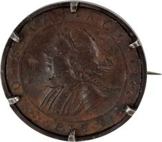 "One of the first American political buttons, this William Pitt ""No Stamp Act"" button from 1766 is struck from copper or brass, and has been remounted as a broach."