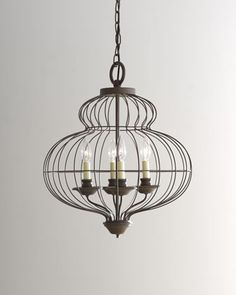 """""""Cage"""" Chandelier. (Horchow: $400) ...Wonder if I could somehow put a chandelier inside a birdcage (Hobby Lobby has a good variety) for a similar look."""