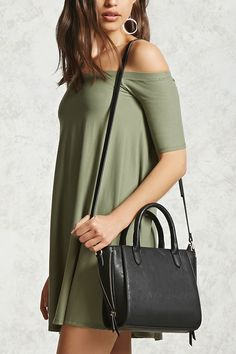 A faux leather satchel featuring a removable crossbody strap, dual top handles, side zipper detail, a zip top closure, an interior slip pocket, and an interior zip pocket.