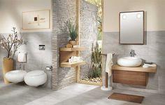 une salle de bain claire avec un vasque ovale et des plantes vertes