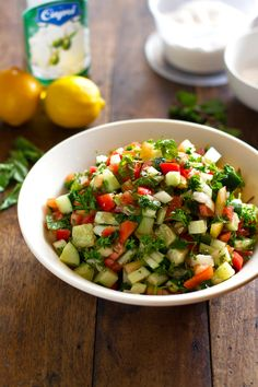 We call this shepherd's salad...simple ingredients, delicious salad.  We eat this everyday in the summer when the tomatoes are abundant, fragrant and cheap.  Tomatoes, cucumbers, onions, mint, flat leaf parsley, salt, pepper, olive oil and lemon juice or pomegranate molasses.  Yum!