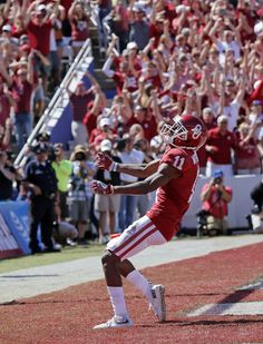 Oklahoma's Dede Westbrook (11) celebrates a touchdown reception in the second quarter during the Red River Showdown college football game between the University of Oklahoma Sooners (OU) and the Texas Longhorns (UT) at Cotton Bowl Stadium in Dallas, Saturday, Oct. 8, 2016. Photo by Nate Billings, The Oklahoman