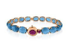 Brumani Corcovado Bangle Bracelet, Fashioned in 18K Rose Gold, Featuring One Oval and One Round Rhodolite Garnet =1.12cts Total Weight, Seventeen Oval London Blue Topaz =43.35cts Total Weight and One Round Diamond =.01cts Total Weight