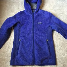 Patagonia fleece This is a purple Patagonia fleece. Kinda looks blue in photo. Had a nice fleece front with a jacket type back. The size tag is cut out but I'm almost positive is it a small. Excellent condition! Patagonia Jackets & Coats Utility Jackets
