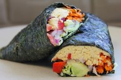 """These """"California-style"""" Vegan Sushi Rolls are jam-packed with hummus, veggies, and flavor! They're easy to make for a healthy and delicious lunch option."""